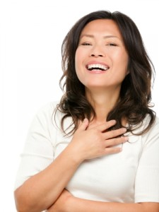 Laughing mature Asian woman