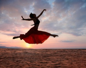 Woman leaping for joy at sunset 130117 shutterstock_22075510 (2)